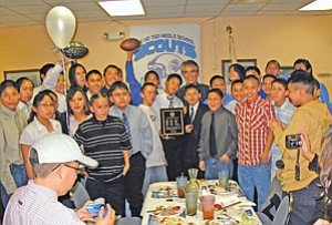 Navajo Nation President Joe Shirley Jr. (center) is surrounded by the 3A National Athletic Conference championship Tse Ho Tso Middle School football team. President Shirley acknowledged the team's accomplishments and encouraged them to be champions in their own lives (Photo by George Hardeen).