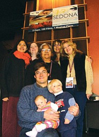 "Old friends gather to celebrate screening of ""Dance of the Warrior Mouse."" They are (top, left to right) Lillian Hill, Andrea Hartley, Marilyn Tewa, Phyllis Hogan, filmmaker Susan Green (bottom, left to right) and Andy Bessler with daughter Ruby and son Noah (Photo by S.J. Wilson/Observer)."