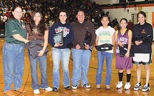 NTUA Crownpoint Sub-Office Supervisor Lucy Cayatineto presents certificates and award jackets to members of the New Mexico district 3A NTUA Sportsmanship team. Pictured from left to right are Lucy Cayatineto, Druanne Yuselew (Zuni), Lindsay Candelaria (Bloomfield), Samantha Enrico (Crownpoint), Shundiin Jones (Newcomb), Andrea Jackson (Tohatchi), and Amber Arviso (Wingate). The presentation was made at the recent district playoffs at Wingate High School (Courtesy photo).
