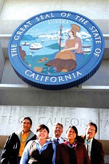 Members of the Just Transition Coalition stand outside of CPUC headquarters in San Francisco. From left: Marshall Johnson of To' Nizhoni Ani, Kim Smith of the Black Mesa Water Coalition, Roger Clark of the Grand Canyon Trust, Wahleah Johns of the Black Mesa Water Coalition and Tony Skrelunas of the Grand Canyon Trust (Photo courtesy of JTC).