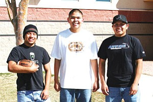 Pictured from left to right are Matt Shirley, running back, age 18; Buck Navaho, quarterback; age 18, and Sport Teller, linebacker, age 18. All will play as freshman for the Tucson based community college this coming fall.  Not pictured but also given full ride scholarships to Pima College are Michel Mathias-Wide, reciever, age 18, and Jerrick Clinton, center, age 17. All players are from the Navajo Nation (Photo by Byron Poocha).