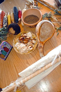 A table at Homol'ovi Ruins State Park near Winslow displays cotton, corn varieties, Hopi cultural objects and plants collected from northern Arizona (Photo by John Bianchini).