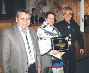 Howard Shanker (center) was honored by the Navajo Nation April 17.During his State of the Nation Address to the Navajo Nation Council, Navajo Nation President Joe Shirley Jr. (right) presented Shanker with a plaque and a special Pendleton robe bearing the Navajo Nation seal. Shanker, who will run for Congress in 2008 against incumbent Rick Renzi in Arizona Congressional District 1, was recognized for his work to protect the sacred San Francisco Peaks from desecration by the federal government and a privately run ski area. Also pictured is Navajo Vice President Ben Shelly (Photo by George Hardeen/NN-OPVP).