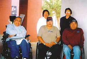 ASSIST! to Independence executive director and board members: (front row) Michael Blatchford (executive director); Arthur Hardy Sr. (board member), and Peterson Yazzie (board president); (back row) Sophia Quotskuyva (board secretary/treasurer) and Judy Talawyma (board member; Courtesy photo).