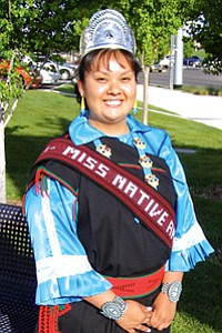 NMSU Miss Native American 2007 Yvette Aguilar, dressed in her Santo Domingo Pueblo traditional attire, represented her university in the Gathering of Nations Pow Wow grand entry on April 27 and 28 in Albuquerque (NMSU Photo by Jane Moorman).