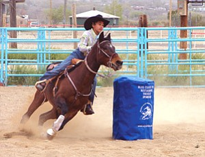 This WJRA cowgirl rounds the third barrel and heads for home during PeeWee Barrel racing (Photo by Debi Farrell).