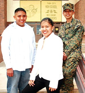 Tuba City High School's 2007 Gates Millennium scholars (L to R): Jordan Begay, LeeAnn DeJolie, and Kevin Attikai. Only 1,000 students from throughout the United States are awarded the Bill and Melinda Gates Scholarship each year. This year Tuba City High School yielded three winners of this highly competitive scholarship award (Photo by Byron Poocha/TCUSD)
