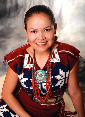 Karletta Chief, dressed in traditional Diné regalia, recently graduated from the University of Arizona with her doctorate in hydrology and water resources (Courtesy photo).