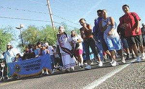 Fort McDowell community members begin the four-mile march from Parks and Recreation to the Fort McDowell Casino during the 2006 Sovereignty Day Commemoration held May 12, 2006. The march re-enacts the three-day march to the Arizona State Capitol protesting the seizure of the tribe's slot machines in May 1992 (Courtesy photo).