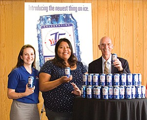 Nackard Companies Marketing and Special Events manager Laura Davis, Pepsi scholarship recipient Cynthia Young and CCC president Tom Jordan show off the newest thing on ice. The limited edition Pepsi can celebrating CCC's 15th anniversary can be found in stores throughout northern Arizona. The commemorative can offers a five dollar ($5) coupon toward non-credit workshops at the college (Photo courtesy of CCC).