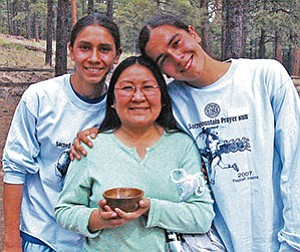Isabelle Walker and her sons, Tenzing and Sakya Calsoyas, celebrate the boys' victory in the 24th Annual NACA Sacred Mountain Prayer Run. Walker is a Deputy Chief of Staff to Navajo Nation President Joe Shirley Jr., and is Vice President of the Birdsprings Chapter (Photo by S.J. Wilson/Observer).