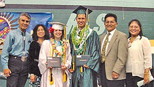 Navajo Nation President Joe Shirley Jr. (left) along with his wife Vikki shared the stage with 2007 Tuba CIty High School (TCHS) valedictorian Jessica Goatcher and salutatorian Christopher Holve along with Hopi Tribal Chairman Ben Nuvamsa and hiswife Lynn at the TCHS graduation on May 26 (Photo by Byron Poocha/TCUSD).