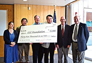 From left: Coconino County Juvenile Court representatives Diedra Silbert and Bryon Matsuda accepted a giant check signed by Pine Canyon Club President Warren Smith and Flagstaff Mayor Joe Donaldson for the Step-Up Scholarship. CCC President Tom Jordan thanked the group for coming together to create the scholarship and college opportunities for young people associated with the juvenile court system. Also pictured is CCC Foundation Director Bob Erb (Photo courtesy of CCC).