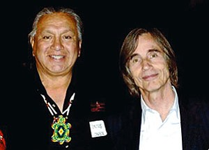 Dennis Bowen, recently honored for his service by the Seva Foundation, poses with singer/songwriter Jackson Browne (Courtesy photo).