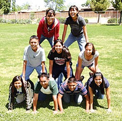 Nine of Tuba City's top 10 seniors show their playful side during a recent outing. Collectively, these seniors garnered close to $950,000 in scholarship funding, including three $25,000 Gates Millenium scholarships (Photo by Byron Poocha/TCUSD).