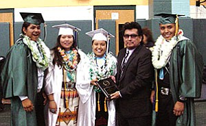 Hopi Tribal member Jacob Coin (second from right) stands with Tuba City High's Class of 2007 class officers after making a donation to the class on hehalf of the San Miguel Band of Mission Indians (Photo by Rosanda Suetopka Thayer/TCUSD).