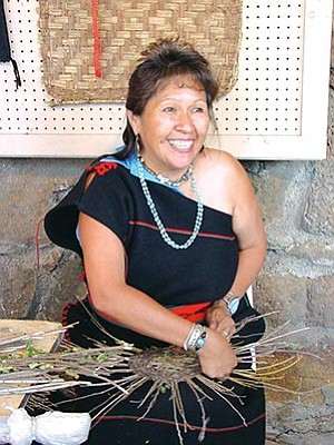 Ruby Chimerica, a traditional basket maker from Bacavi Village, was one of the weekend Hopi Show demonstrators (Photo by Rosanda Suetopka Thayer).