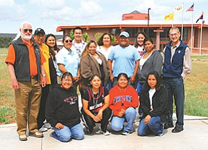 Front row (kneeling, left to right):   Leanna Barber, Shiprock; Alaina K., Shiprock; Tamara Tacheene, Jeddito; Rochelle Benally, Hogback. Back row (standing left to right):  Edward Garrison, Diné College Faculty; Myrtis Anderson, Shiprock; Latoya Dale, Shiprock; Carol Goldtooth-Begay, University of Arizona College of Public Health; Jalen Redhair, Kayenta; Jonelda Dodge, Shiprock; Vangie Martinez, Chinle; Quentin R. Aspaas, Fort Defiance; Miriam Platero, Kayenta; Melissa Benally Clark, Shiprock;  Mark Bauer, Diné College Faculty (Photo by Ed McCombs).