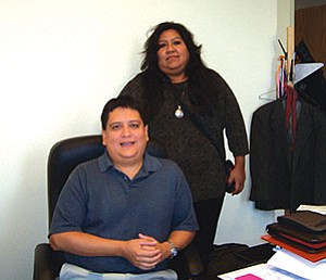 Lucinda Hughes-Juan (standing) and Kenneth Poocha pose for a photo. Hughes-Juan, a member of the Tohono O'odham Tribe, was recently selected to chair the Arizona Commission of Indian Affairs (AICA). Poocha, from the Hopi Tribe, is executive director of the AICA (Courtesy photo).
