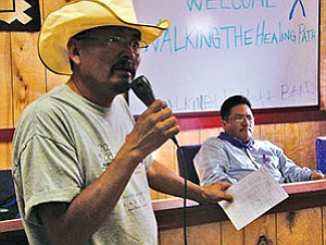 Council Delegate Leonard Chee (with microphone) of the Leupp/Birdsprings/Tolani Lake Chapters speaks to the domestic violence situation happening in Leupp. Thomas Walker Jr. (at right) also a Council Delegate for the three chapters, listens in. Walker spoke earlier of the loss of a sister to domestic violence (Photo by S.J. Wilson/Observer).