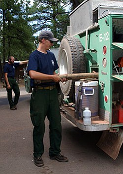 When firefighters are not on a wildland fire, they will work on preparing for prescribed fires, thinning the forest, physical training, and working on hose deployment and training with pumps to gain expedience on the job.