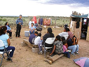Navajo President Joe Shirley, Jr., and First Lady Vikki Shirley visited the shack where Wilton Davis, Karrie Manuelito and their children are living in Kinlichee. The President said the conditions were appalling and that Navajo officials need to work together to address the family's situation. He said no family should have to live in such conditions in the United States (Photo by George Hardeen, NN-OPVP).