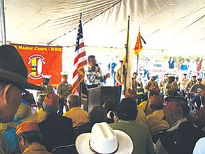 "Navajo President Joe Shirley, Jr., tells hundreds of Navajos and the 24 Navajo Code Talkers being honored that ""these young men"" made sacrifices to defend their country while preserving their Navajo homeland and way of life during World War II. The event took place on the first official Navajo Code Talkers Day Celebration at Veterans Park in Window Rock on Aug. 14 (Photo by T.C. Tso)."