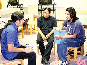 Raven Chacon (left) talks to students (Photo by Byron Poocha/TCUSD).
