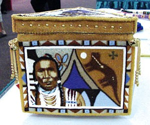 Showing the highly creative style of the traditional form of beadwork, this hide covered frame was done with tiny Czechoslovakian beads and had a realistic full face depiction as its subject (Photo by Rosanda Suetopka Thayer).
