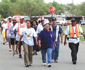 "During the Navajo Nation domestic violence awareness and education walk entitled ""Walking the Healing Path,"" Democratic Arizona Congressional District 1 candidate Howard Shanker (second from right) joined the movement (Courtesy photo)."
