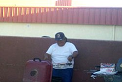 John Coochyumptewa Sr. works on the grill.
