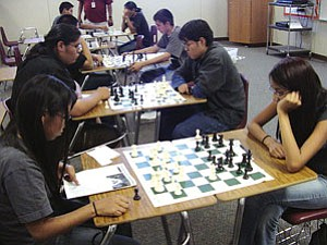Members of the TC High Warrior Chessmen team contemplate their next moves.