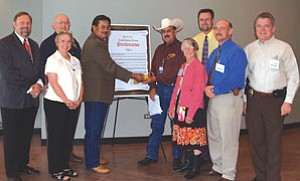 Officials gather at Northland Pioneer College in Snowflake to sign a proclamation declaring September National Alcohol and Drug Addiction Recovery Month in northeastern Arizona. From left, Judge David Widmaier, Navajo County School superintendent Linda Morrow, Show Low vice mayor Gordon Kearl, Navajo County supervisors Jesse Thompson and J.R. DeSpain, Pinetop-Lakeside Mayor Barbara Teague, Pinetop-Lakeside councilor Dave Clark, Eagar Police Chief Mike Hogan and Pinetop-Lakeside Police Chief Woody Eldredge (Courtesy photo).