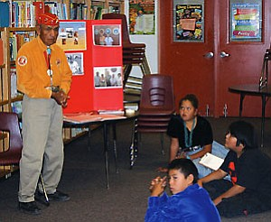 World War II Code Talker George Smallcanyon shares his experiences with seventh graders in the Leupp School library (Photo by Rebecca Schubert/NHO).
