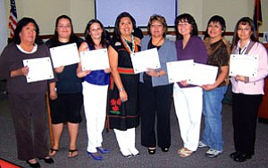 Wi$e Up participants and supporters celebrate their success at the Wi$e Up graduation held Oct. 15. Pictured from left are: Jenny Erwin, U.S. DOL Women's Bureau regional administrator, Deborah Patrick (Hopi), Amber Patrick (Hopi), Raylene Hood (Yavapai Apache), Holly Figueroa (Hopi) Coconino County Career Center administrative specialist and Wi$e Up instructor, Vanita Apodaca (Diné), Gwen Cody (Diné),  Roanna Jenkins (Hopi) and Carla Chiquito (Diné) and Shinea Chun, U.S. DOL Women's Bureau director (Courtesy photo).