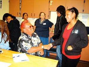 Hopi High radio class president Traci Talahytewa welcomes D.J. Jade, producer of the radio show at Alamo Community School (Photo by Stan Bindell/NHO).