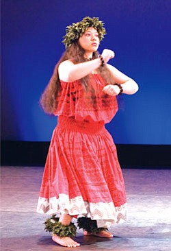A member of BYU's Living Legends performs a traditional dance from Hawaii. It depicts elements of creation, such as mountains, volcanoes and the ocean (Courtesy photo).