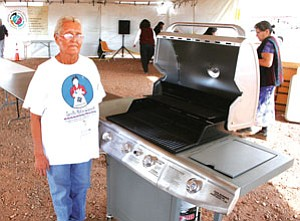 Clara Wilson of Winslow stands with her new gas grill earned by her delicious chili (Courtesy photo).
