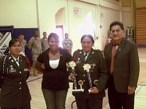 From left: Cadet Major Percelia Batala, Cadet Lieutenant Colonel Leandra Calnimptewa and Cadet Corporal Carrie Jones pose after receiving the First Place Academic Trophy, which was presented by Hopi Chairman Ben Nuvamsa (Courtesy photo).
