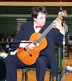 """Francesc De Paula Soler plays a """"Fleta"""" guitar which is considered to be the best handmade classical guitar in the world (Photo by Rosanda Suetopka Thayer/TCUSD)."""
