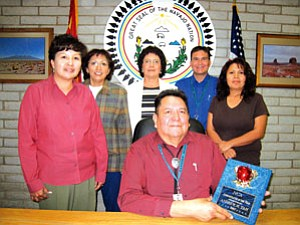 Standing from left: Rena Dodson, Human Resource director; Marie Morales, Federal Project director; Stella Claw, Navajo Language teacher; Dwight Witherspoon, Dean of Students; Trevia Knight business manager and Andrew Tah superintendent (seated; Photo by Josepine Billy).