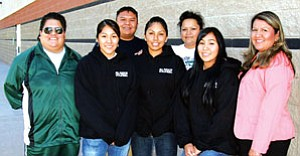 Tuba City High's winning 2007 Girls Volleyball Team (front row from left): head coach Flora Sombrero, Dakota Yazzie, Danielle Hoover, Nicole Yellow and Jacquelyn Wauneka-TCHS principal. Back row from left: assistant coach Harlan Barlow and assistant coach Reva Hoover. Not pictured is Evelyn Kiyaani, who temporaily took over head coaching duties Oct. 30 (Photo by Rosanda Suetopka Thayer/TCUSD)