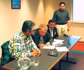 Navajo Nation President Joe Shirley Jr. and Navajo Nation Vice President Ben Shelly look on after signing the Navajo-Gallup MOU to partner for the Navajo-Gallup Water Supply Project. Gallup Mayor Harry Mendoza joined President Shirley and Vice President Shelley to sign the historic document Oct. 30 (Photo by George Hardeen/NN-OPVP).