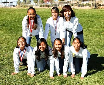 TC High 2007 girls cross country team. At bottom (left to right): Tatiyanah Johnson, Ellen Smiley, Shelbi Little and Caitlin Williams. At top (left to right): Nicolette Hatathlie, Jennifer Williams and Kara Dugi. Not pictured is Girls XC Head Coach Richard Dawavendewa (Photo by Byron Poocha/TCUSD).