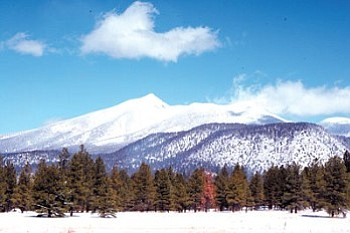 The sacred San Francisco Peaks blanketed in pure white snow following a snowstorm (Photo by Jeff Brostrom/NHO file photo).