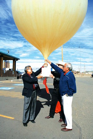 Robert Nakai (left), program manager, NNSDP; Eddie Browning, state director, USDA; and Peterson Zah, advisor and Resource Consultant to Space Data from ASU launch a balloon fitted with a transreceiver in front of the NNSDP Wellness Center in Window Rock Nov 20 (Courtesy photo).