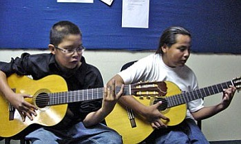 Adam Nez (left) and his guitar partner, Adam Tso are two outstanding young performing artists being nurtured by the music program at Tuba City Junior High School. Both the junior high and high school at TCUSD offer extensive music programs with teachers Morris Nesmith and Blair Quamahongnewa.