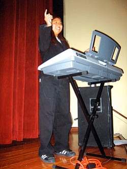 """BriAnn """"Boo Boo"""" Laban played the keyboard for the show (Photo by Stan Bindell/NHO)."""