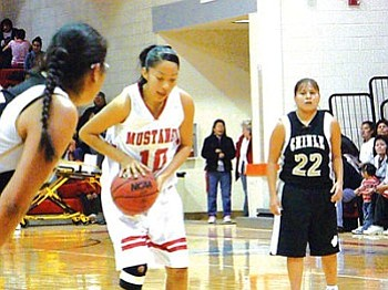 Top photo: Monument Valley Lady Mustangs' Denetria Yazzie (10) at the line in the fourth quarter in an important 3A North Region Conference contest (Photo by Anton Wero/NHO).
