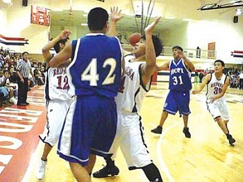 Red Mesa applies pressure in the final quarter on Hopi's Roper Crook (Photo by Anton Wero/NHO).